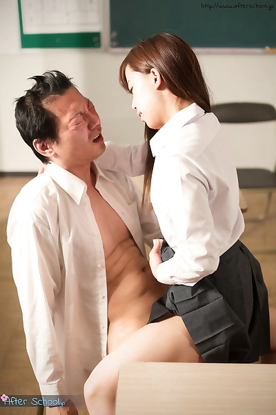 Asian schoolgirl sits on..