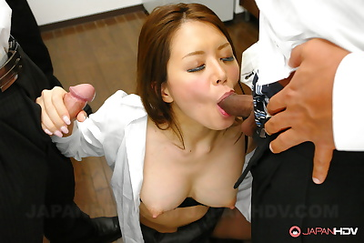 Erotic Asian woman sucks..